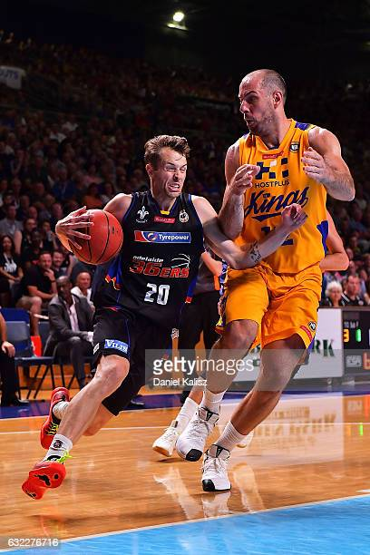 Nathan Sobey of the Adelaide 36ers drives to the basket as Aleks Maric of the Sydney Kings defends during the round 16 NBL match between the Adelaide...