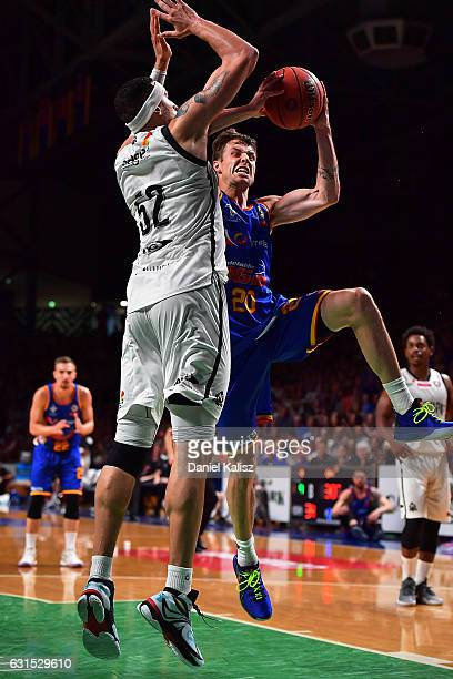 Nathan Sobey of the Adelaide 36ers shoots over Josh Boone of Melbourne United during the round 15 NBL match between the Adelaide 36ers and Melbourne...