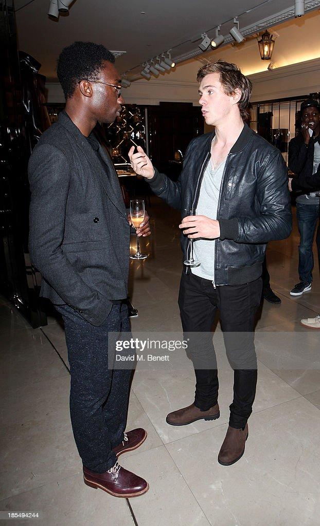 Nathan Stewart Jarrett (L) and Sam Keeley attend the BAFTA 'Breakthrough Brits' event at Burberry 121 Regent Street, London on October 21, 2013 in London, United Kingdom.