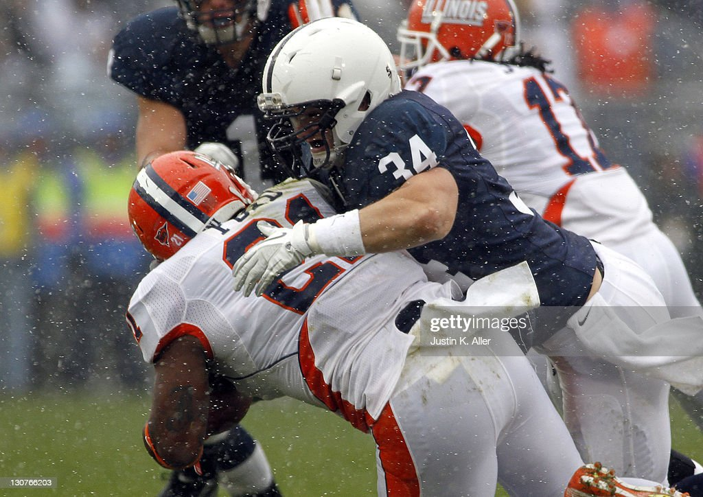 Nathan Stupar #34 of the Penn State Nittany Lions tackles Jason Ford #21 of the Illinois Fighting Illini during the game on October 29, 2011 at Beaver Stadium in State College, Pennsylvania.