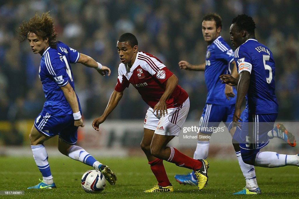 Nathan Thompson (2L) of Swindon Town cuts between <a gi-track='captionPersonalityLinkClicked' href=/galleries/search?phrase=David+Luiz&family=editorial&specificpeople=4133397 ng-click='$event.stopPropagation()'>David Luiz</a> (L), <a gi-track='captionPersonalityLinkClicked' href=/galleries/search?phrase=Juan+Mata&family=editorial&specificpeople=4784696 ng-click='$event.stopPropagation()'>Juan Mata</a> (2R) and <a gi-track='captionPersonalityLinkClicked' href=/galleries/search?phrase=Michael+Essien&family=editorial&specificpeople=523500 ng-click='$event.stopPropagation()'>Michael Essien</a> (R) of Chelsea during the Capital One Cup third round match between Swindon Town and Chelsea at the County Ground on September 24, 2013 in Swindon, England.