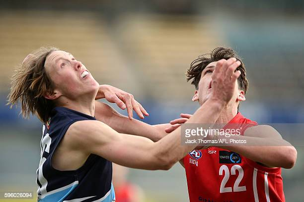 Nathan Twigg of the Pioneers and Joshua Patullo of the Power compete for the ball during the round 18 TAC Cup match between Gippsland Power and...