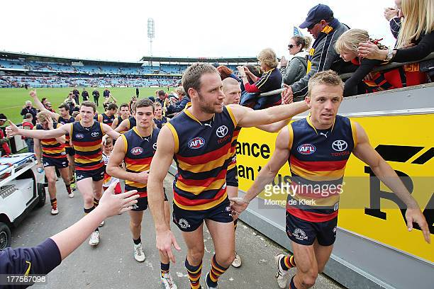 Nathan van Berlo of the Crows leads the team from AAMI stadium after their last game at this venue after the round 22 AFL match between the Adelaide...