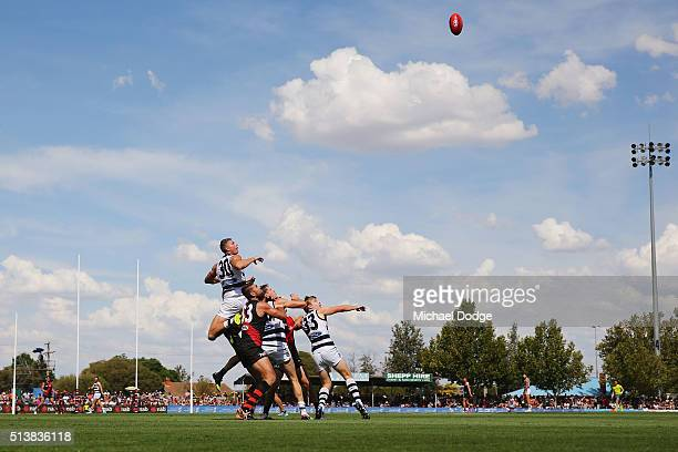 Nathan Vardy of the Cats leaps over a pack for a high mark attempt during the 2016 AFL NAB Challenge match between the Essendon Bombers and the...