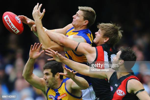 Nathan Vardy of the Eagles and Michael Hurley of the Bombers compete for the ball during the round nine AFL match between the Essendon Bombers and...