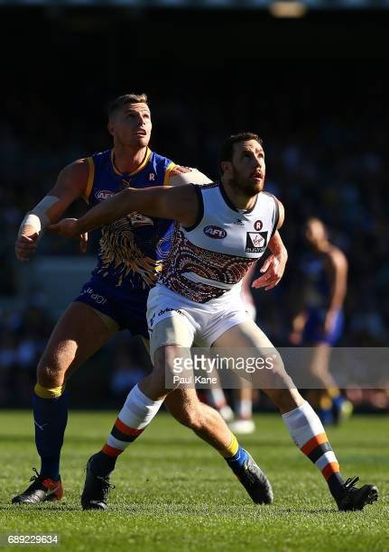 Nathan Vardy of the Eagles and Shane Mumford of the Giants contest a boundary throw in during the round 10 AFL match between the West Coast Eagles...