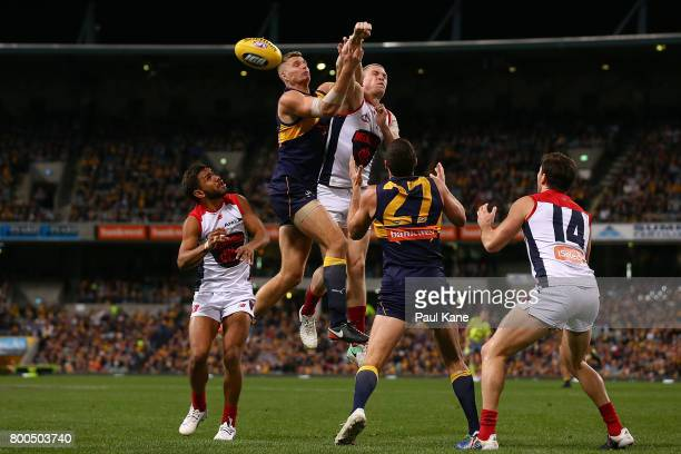 Nathan Vardy of the Eagles and Tom McDonald of the Demons contest for the ball during the round 14 AFL match between the West Coast Eagles and the...
