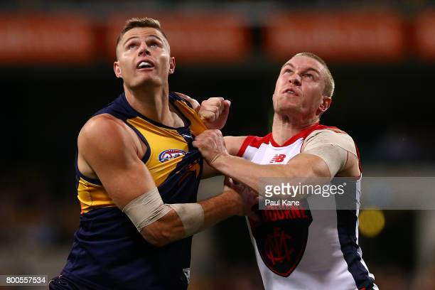 Nathan Vardy of the Eagles and Tom McDonald of the Demons contest the ruck during the round 14 AFL match between the West Coast Eagles and the...