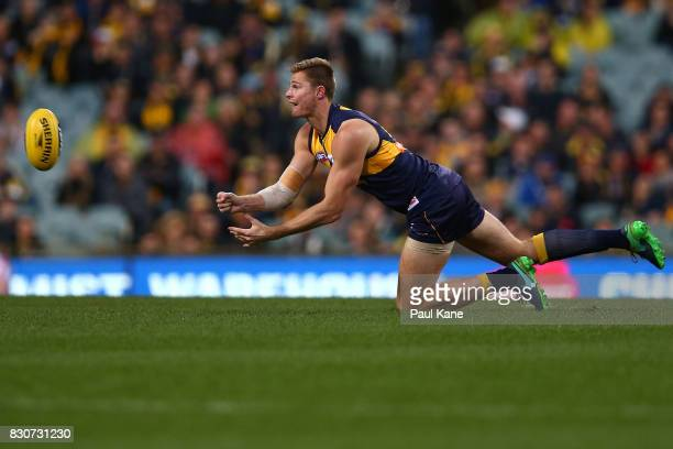 Nathan Vardy of the Eagles handballs during the round 21 AFL match between the West Coast Eagles and the Carlton Blues at Domain Stadium on August 12...
