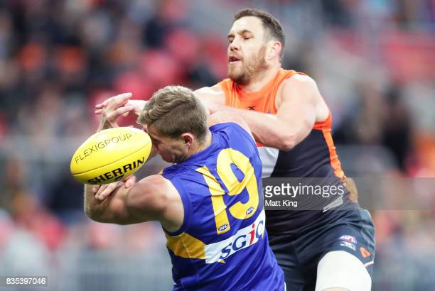 Nathan Vardy of the Eagles is challenged by Shane Mumford of the Giants during the round 22 AFL match between the Greater Western Sydney Giants and...