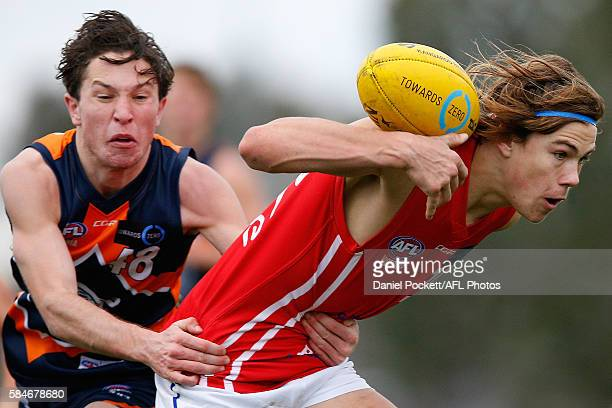 Nathan Voss of the Power and Liam Middleton of the Cannons contest the ball during the round 15 TAC Cup match between Calder and Gippsland at RAMS...