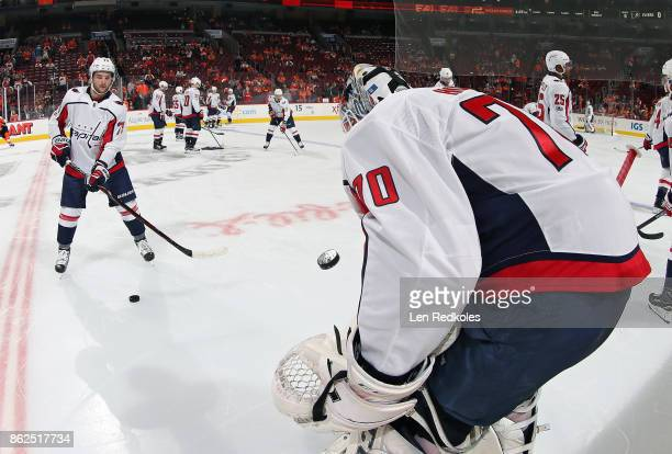 Nathan Walker and Braden Holtby of the Washington Capitals warm up prior to their game against the Philadelphia Flyers on October 14 2017 at the...