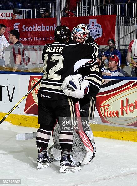 Nathan Walker and Justin Peters of the Hershey Bears celebrate their series victory over the Toronto Marlies during AHL Eastern Conference Final...