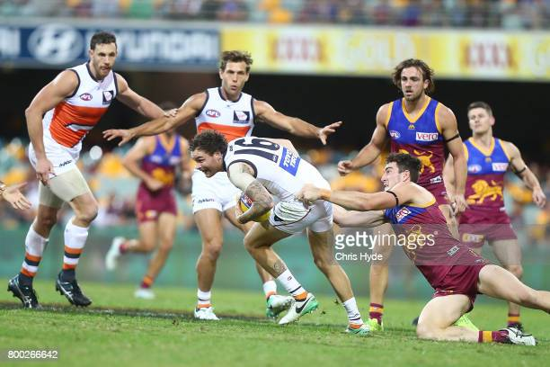 Nathan Wilson of the Giants runs the ball during the round 14 AFL match between the Brisbane Lions and the Greater Western Sydney Giants at The Gabba...