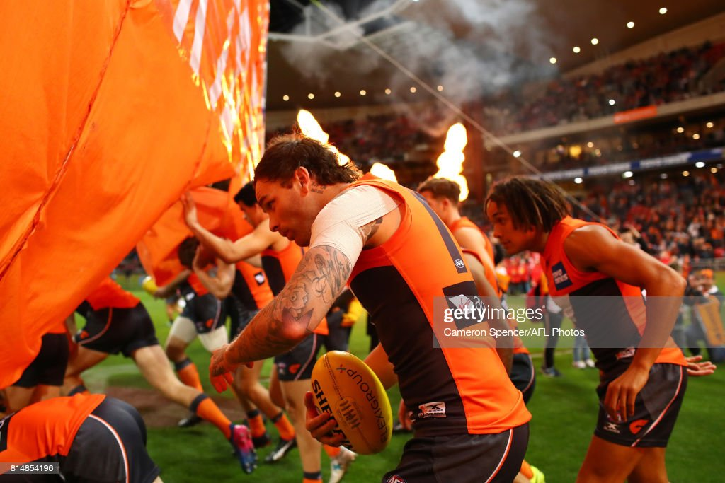 Nathan Wilson of the Giants runs through the Giants banner during the round 17 AFL match between the Greater Western Sydney Giants and the Sydney Swans at Spotless Stadium on July 15, 2017 in Sydney, Australia.