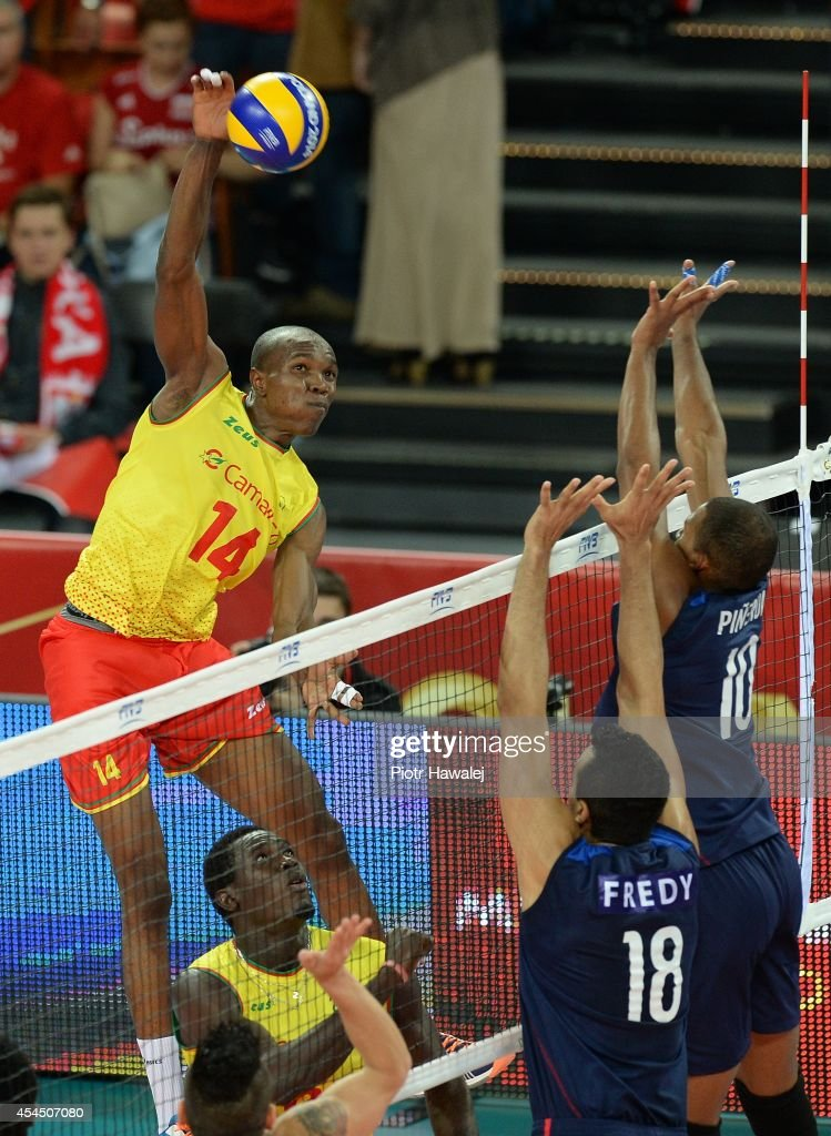 Nathan Wounembaina of Cameroon spikes the ball during the FIVB World Championships match between Venezuela and Cameroon on September 2, 2014 in Wroclaw, Poland.