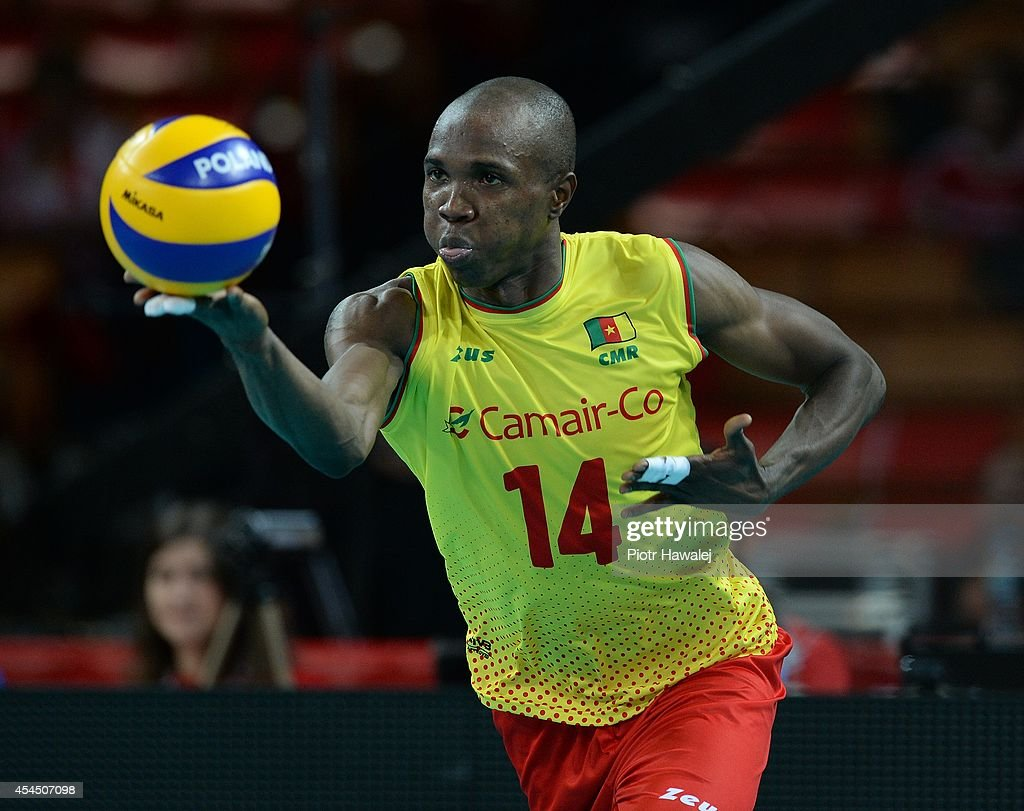 Nathan Wounembaina serves the ball during the FIVB World Championships match between Venezuela and Cameroon on September 2, 2014 in Wroclaw, Poland.