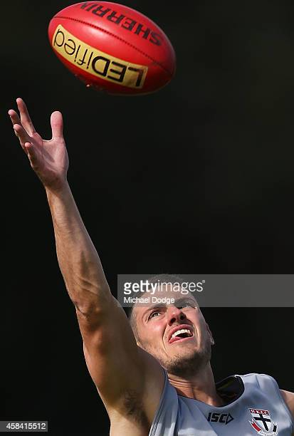 Nathan Wright gathers the ball during a StKilda Saints AFL training session at Linen House Oval on November 5 2014 in Melbourne Australia