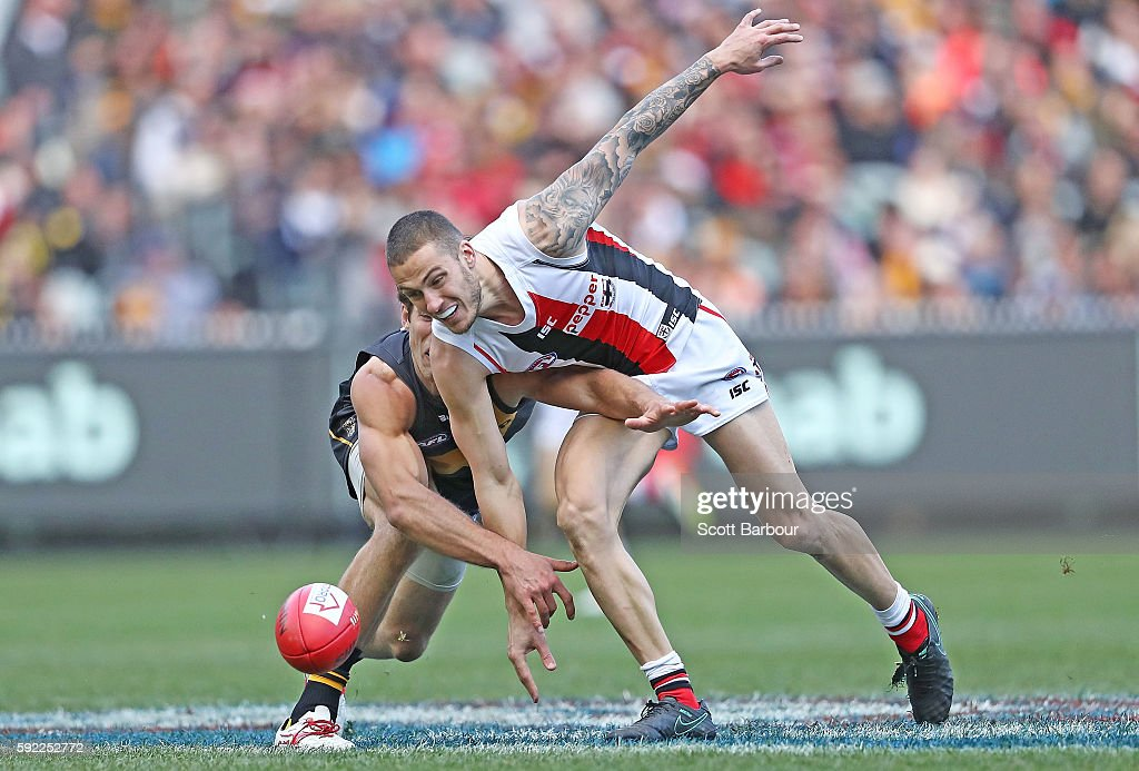 Nathan Wright of the Saints and Alex Rance of the Tigers compete for the ball during the round 22 AFL match between the Richmond Tigers and the St...