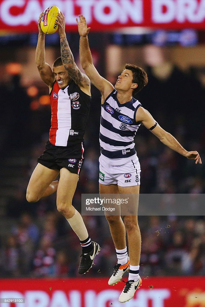Nathan Wright of the Saints marks the ball against Andrew Mackie of the Cats during the round 14 AFL match between the St Kilda Saints and the Geelong Cats at Etihad Stadium on June 25, 2016 in Melbourne, Australia.