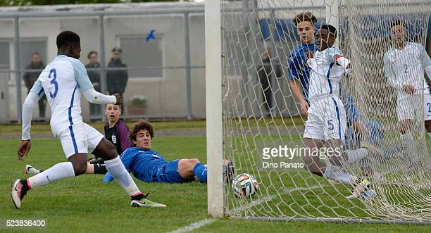 Nathanael Ogbeta of England U15 saves a shot from Roberto Piccoli of Italy U15 competes during the U15 International Tournament match between Italy...
