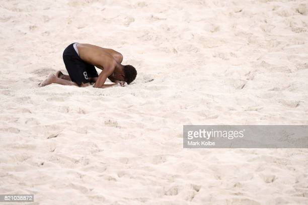 Nathaniel Brown of Trinidad Tobago looks dejected after defeat during the boy's beach soccer gold medal final match between Saint Lucia and Trinidad...