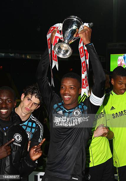 Nathaniel Chalobah captain of Chelsea holds the trophy aloft after victory against Blackburn Rovers during the FA Youth Cup Final 2nd leg match...