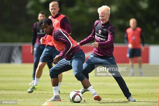 Nathaniel Chalobah in action with Will Hughes during the England U21 Training Session at St Georges Park on June 9 2015 in BurtonuponTrent England