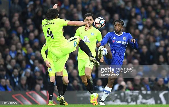 Nathaniel Chalobah of Chelsea and Michael Bostwick of Peterborough United battle for possession during The Emirates FA Cup Third Round match between...