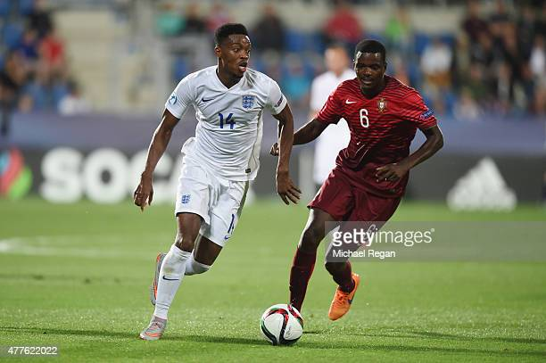Nathaniel Chalobah of England in action with William Carvalho of Portgual during the UEFA Under21 European Championship 2015 Group B match between...