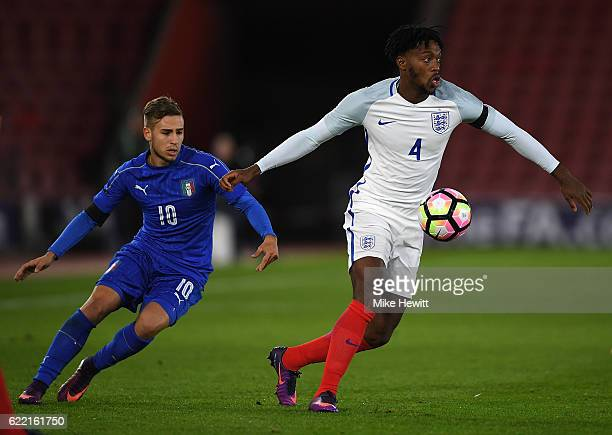 Nathaniel Chalobah of England is challenged by Federico Ricci of Italy during the U21 International Friendly between England and Italy at St Mary's...