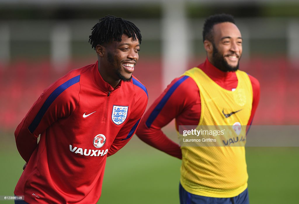 Nathaniel Chalobah of England U-21 shares a joke with Nathan Redmond during a training session at St Georges Park on October 4, 2016 in Burton-upon-Trent, England.