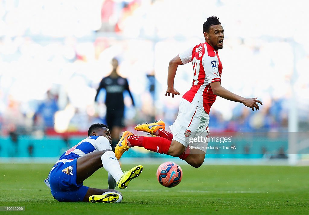 Nathaniel Chalobah of Reading challenges Francis Coquelin of Arsenal during the FA Cup SemiFinal match between Arsenal and Reading at Wembley Stadium...
