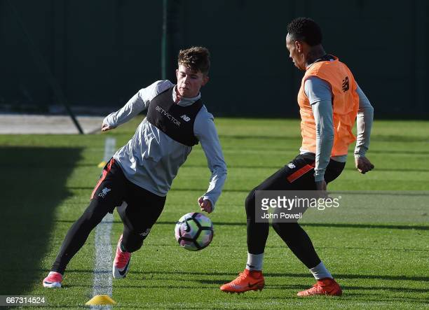 Nathaniel Clyne and Ben Woodburn of Liverpool during a training session at Melwood Training Ground on April 11 2017 in Liverpool England