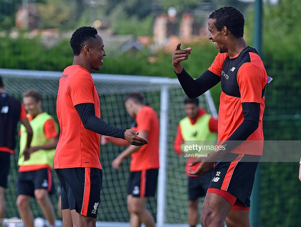 Nathaniel Clyne and Joel Matip of Liverpool during a training session at Melwood Training Ground on September 18, 2016 in Liverpool, England.