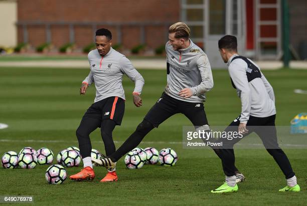 Nathaniel Clyne Loris Karius and Philippe Coutinho of Liverpool during a training session at Melwood Training Ground on March 7 2017 in Liverpool...
