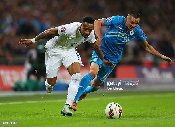 Nathaniel Clyne of England battles with Andraz Kirm of Slovenia during the EURO 2016 Qualifier Group E match between England and Slovenia at Wembley...