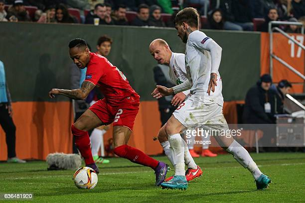 Nathaniel Clyne of FC Liverpool Tobias Werner of FC Augsburg and Konstantinos Stafylidis of FC Augsburg battle for the ball during the UEFA Europa...