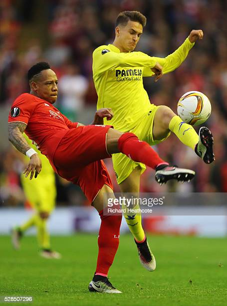 Nathaniel Clyne of Liverpool and Denis Suarez of Villarreal challenge for the ball during the UEFA Europa League semi final second leg match between...