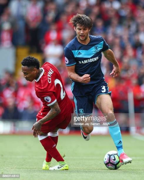 Nathaniel Clyne of Liverpool and George Friend of Middlesbrough during the Premier League match between Liverpool and Middlesbrough at Anfield on May...