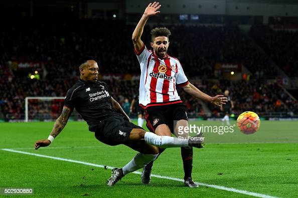 Nathaniel Clyne of Liverpool battles for the ball with Fabio Borini of Sunderland during the Barclays Premier League match between Sunderland and...