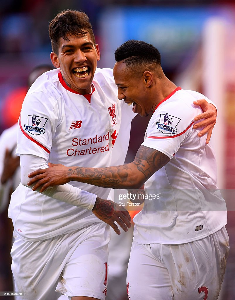 <a gi-track='captionPersonalityLinkClicked' href=/galleries/search?phrase=Nathaniel+Clyne&family=editorial&specificpeople=5738873 ng-click='$event.stopPropagation()'>Nathaniel Clyne</a> of Liverpool celebrates with team-mate <a gi-track='captionPersonalityLinkClicked' href=/galleries/search?phrase=Roberto+Firmino&family=editorial&specificpeople=7522629 ng-click='$event.stopPropagation()'>Roberto Firmino</a> after scoring his team's fifth goal during the Barclays Premier League match between Aston Villa and Liverpool at Villa Park on February 14, 2016 in Birmingham, England.