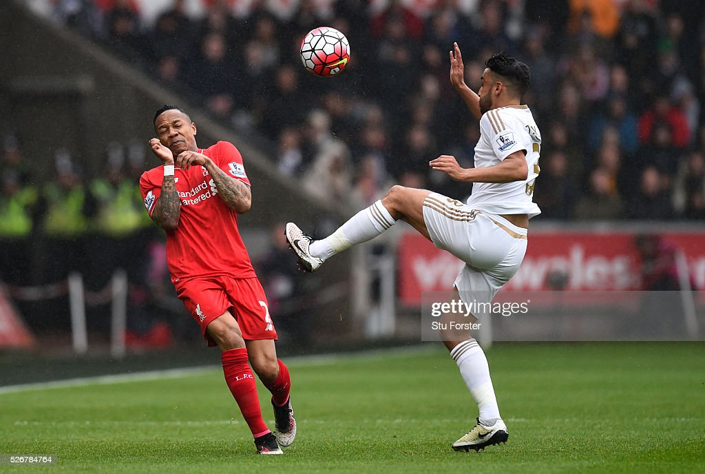 <a gi-track='captionPersonalityLinkClicked' href=/galleries/search?phrase=Nathaniel+Clyne&family=editorial&specificpeople=5738873 ng-click='$event.stopPropagation()'>Nathaniel Clyne</a> of Liverpool closes down Neil Taylor of Swansea City during the Barclays Premier League match between Swansea City and Liverpool at The Liberty Stadium on May 1, 2016 in Swansea, Wales.