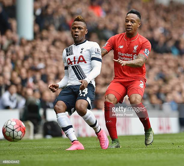 Nathaniel Clyne of Liverpool competes with Clinton Njie of Tottenham Hotspur during the Barclays Premier League match between Tottenham Hotspur and...