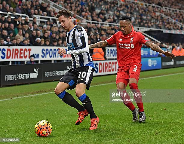 Nathaniel Clyne of Liverpool competes with Florian Thauvin of Newcastle United during the Barclays Premier League match between Newcastle United and...