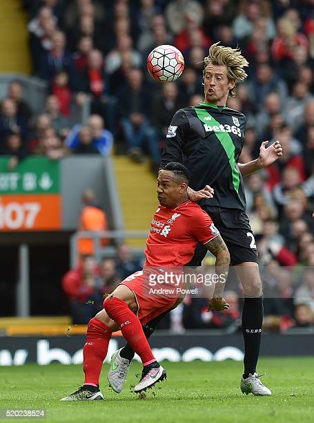 Nathaniel Clyne of Liverpool competes with Peter Crouch of Stoke City during the Barclays Premier League match between Liverpool and Stoke City at...