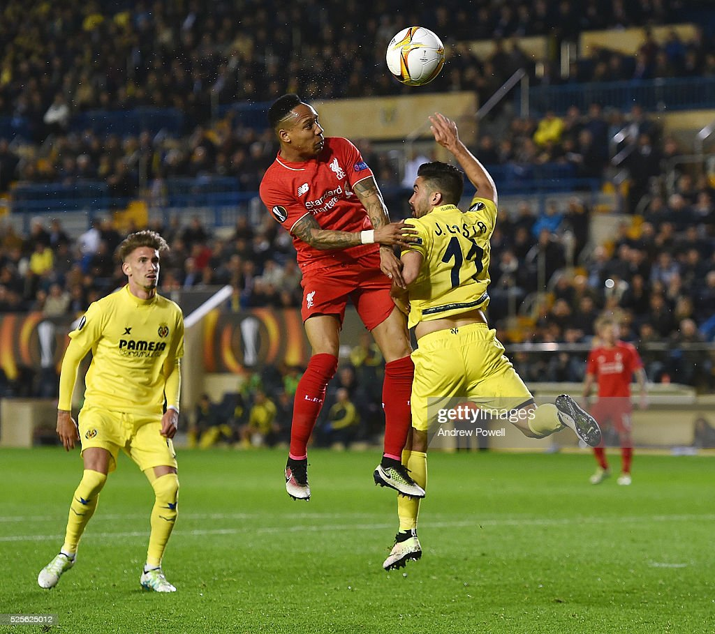 Nathaniel Clyne of Liverpool goes up with Jaume of Villarreal during the UEFA Europa League Semi Final: First Leg match between Villarreal CF and Liverpool on April 28, 2016 in Villarreal, Spain.