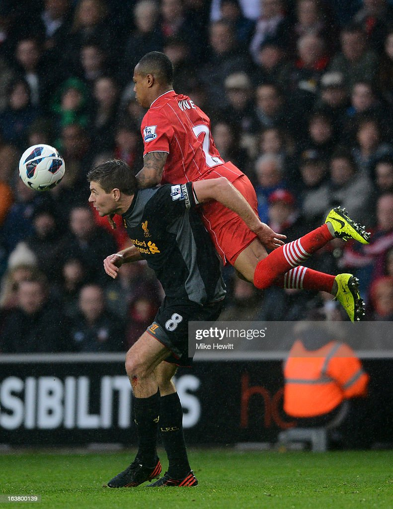 Nathaniel Clyne of Southampton climbs ahead of Steven Gerrard of Liverpool to head the ball during the Barclays Premier League match between Southampton and Liverpool at St Mary's Stadium on March 16, 2013 in Southampton, England.