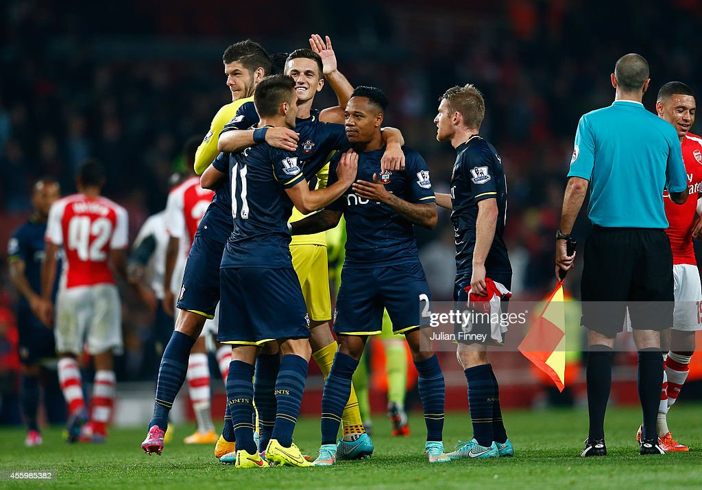 Nathaniel Clyne of Southampton is congratulated at full time after their 2-1 win during the Capital One Cup Third Round match between Arsenal and Southampton at the Emirates Stadium on September 23, 2014 in London, England.