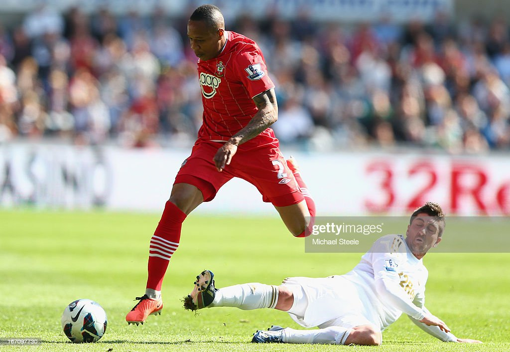 <a gi-track='captionPersonalityLinkClicked' href=/galleries/search?phrase=Nathaniel+Clyne+-+Soccer+Player&family=editorial&specificpeople=5738873 ng-click='$event.stopPropagation()'>Nathaniel Clyne</a> (R) of Southampton leaps above the challenge Pablo Hernandez (R) of Swansea City during the Barclays Premier League match between Swansea City and Southampton at the Liberty Stadium on April 20, 2013 in Swansea, Wales.